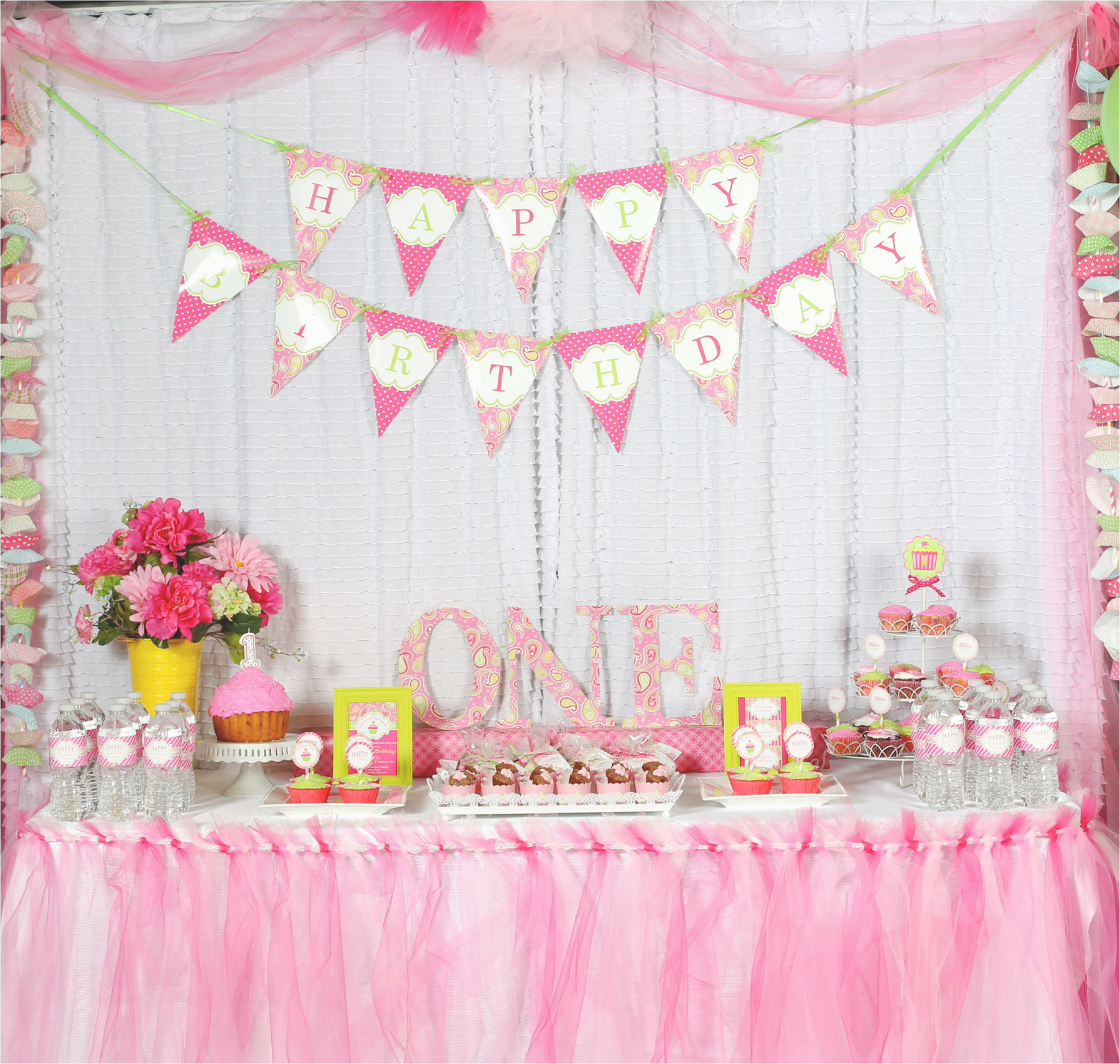 a cupcake themed 1st birthday party with paisley and polka dots