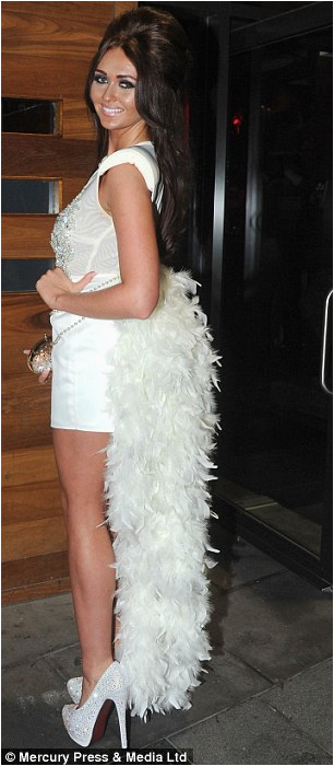 charlotte dawson shakes her tail feather in a white