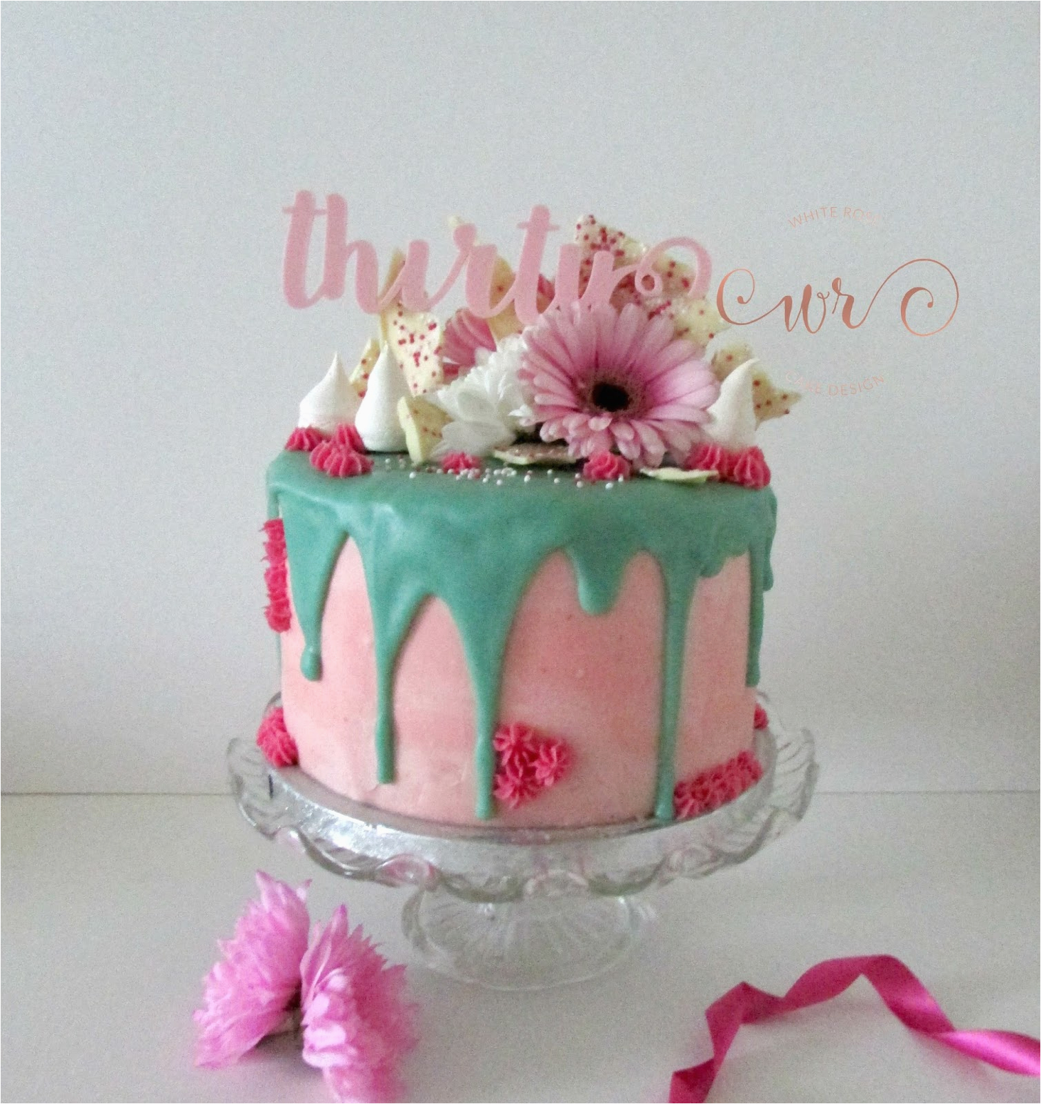 pink and teal drippy 30th birthday cake