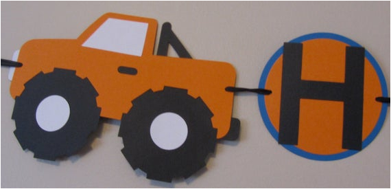 orange and blue monster truck happy