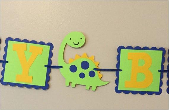 blue green and yellow dinosaur happy