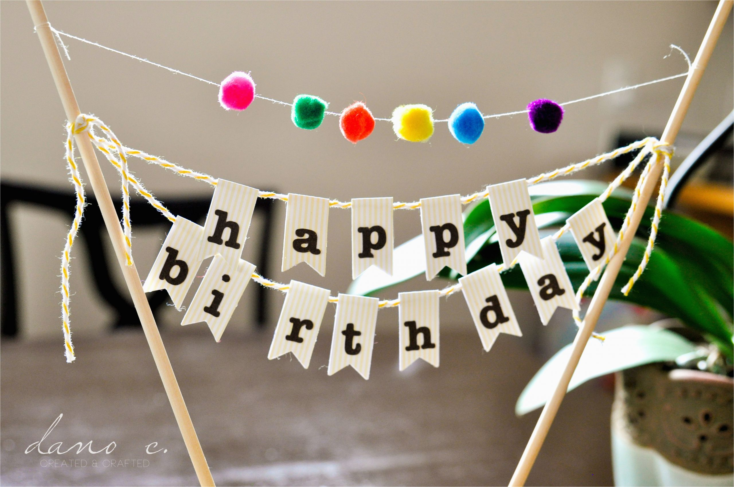 diy birthday cake banner with pom poms