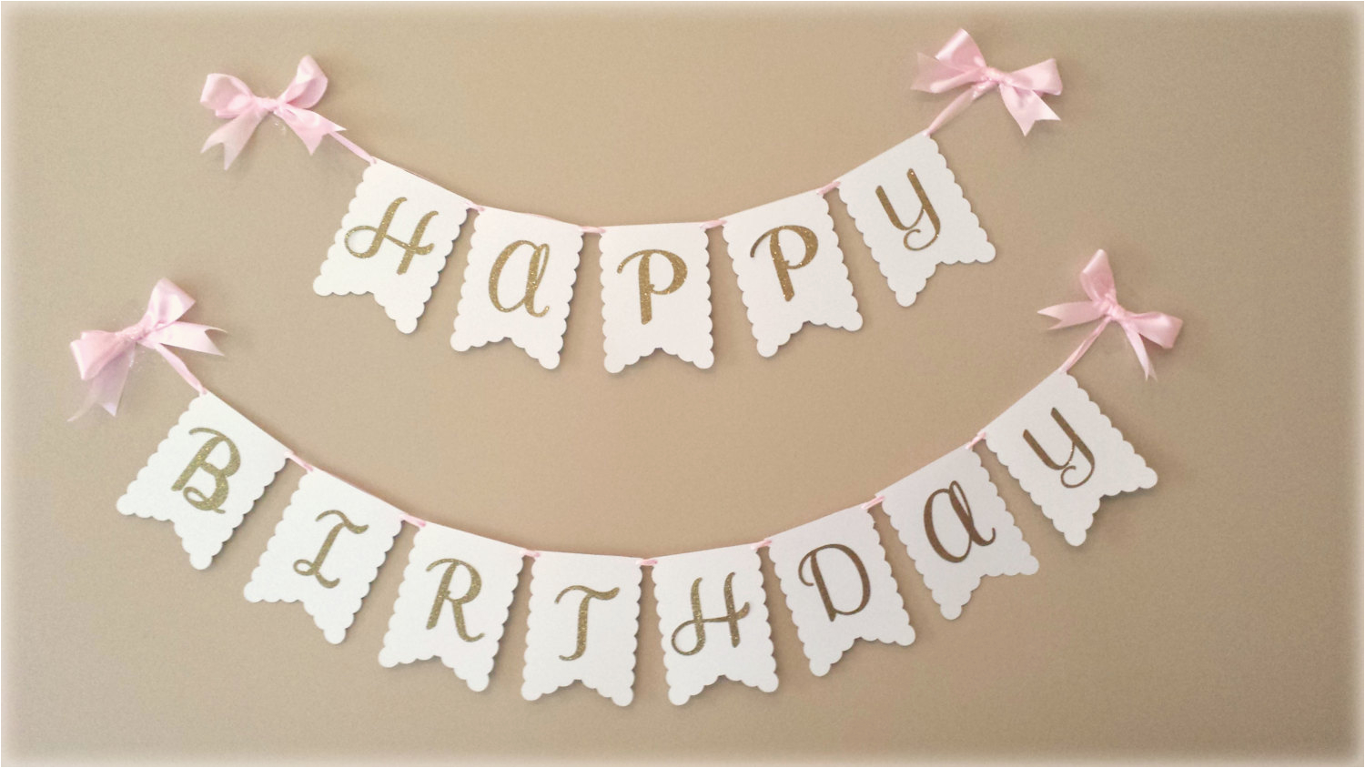 happy birthday banner in gold with white