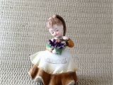 Lefton Birthday Girl Figurines Vintage Lefton February Geo Birthday Girl Flower Purple